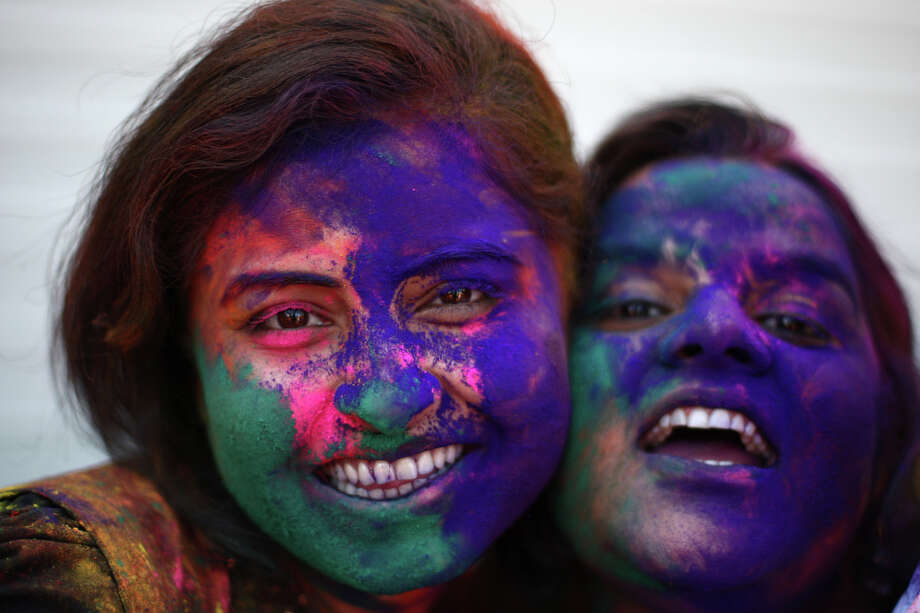 Minakshi Singh, left, and Neah Singh show off their colorful faces during a celebration of Holi, the Hindu festival of colors on Saturday, March 30, 2013 at the Sanatan Dharma Temple & Cultural Center in Maple Valley. The annual cultural and religious event is a time for Hindus to enjoy spring's abundant colors and say farewell to winter. Photo: JOSHUA TRUJILLO / SEATTLEPI.COM