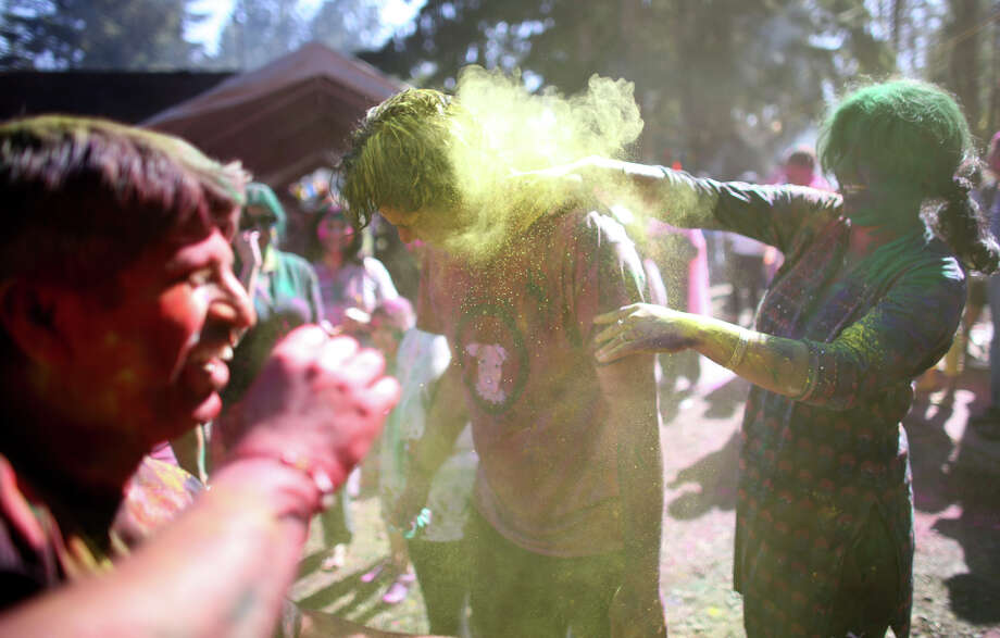 Participant get colorful during a celebration of Holi, the Hindu festival of colors on Saturday, March 30, 2013 at the Sanatan Dharma Temple & Cultural Center in Maple Valley. The annual cultural and religious event is a time for Hindus to enjoy spring's abundant colors and say farewell to winter. Photo: JOSHUA TRUJILLO / SEATTLEPI.COM