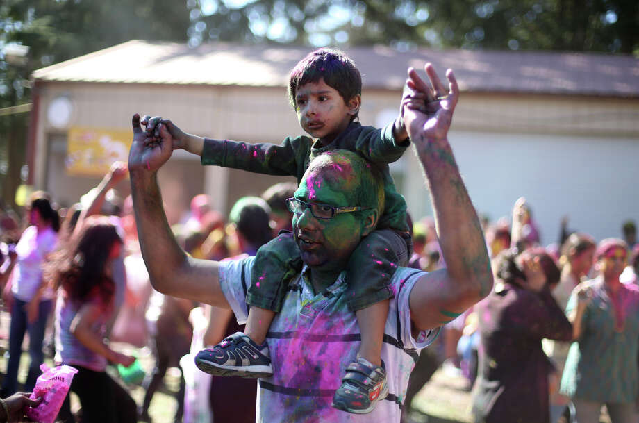 Participants dance during a celebration of Holi, the Hindu festival of colors on Saturday, March 30, 2013 at the Sanatan Dharma Temple & Cultural Center in Maple Valley. The annual cultural and religious event is a time for Hindus to enjoy spring's abundant colors and say farewell to winter. Photo: JOSHUA TRUJILLO / SEATTLEPI.COM