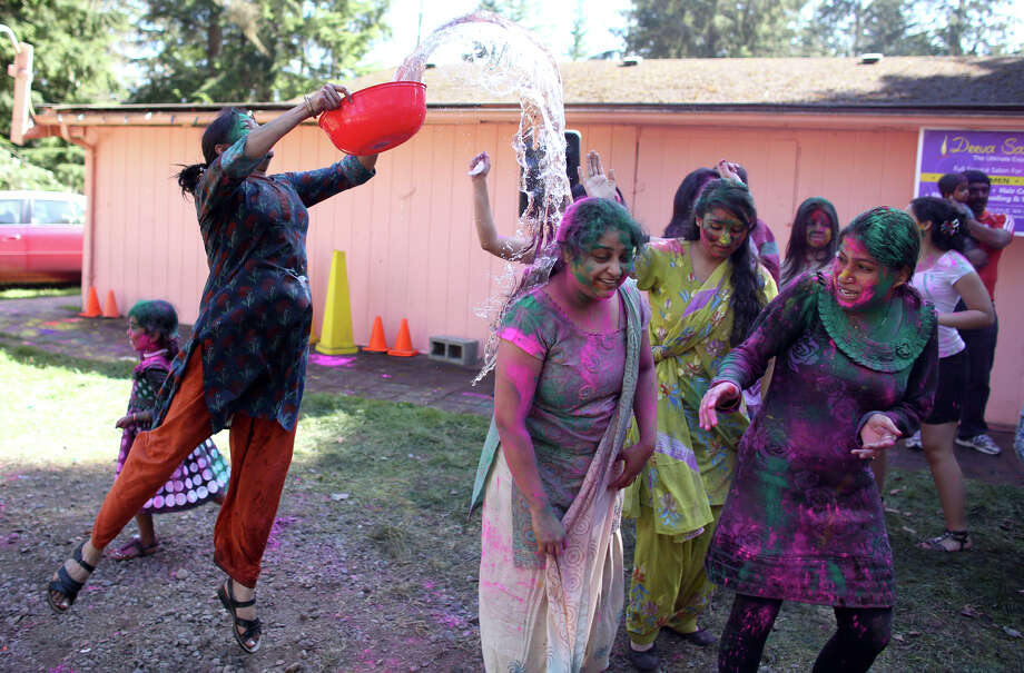 Water is thrown on dancers during a celebration of Holi, the Hindu festival of colors on Saturday, March 30, 2013 at the Sanatan Dharma Temple & Cultural Center in Maple Valley. The annual cultural and religious event is a time for Hindus to enjoy spring's abundant colors and say farewell to winter. Photo: JOSHUA TRUJILLO / SEATTLEPI.COM