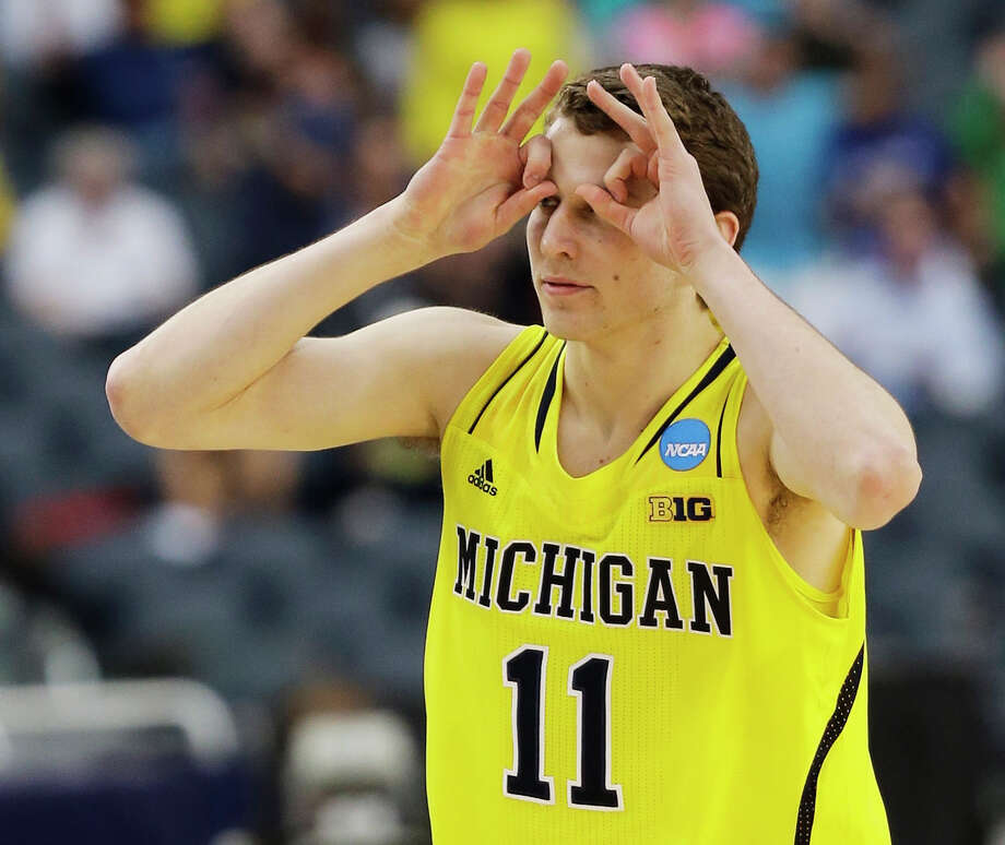 Michigan's Nik Stauskas reacts after making a three-point shot during the first half of a regional final game against Florida in the NCAA college basketball tournament, Sunday, March 31, 2013, in Arlington, Texas. (AP Photo/David J. Phillip) Photo: David J. Phillip, Associated Press / AP