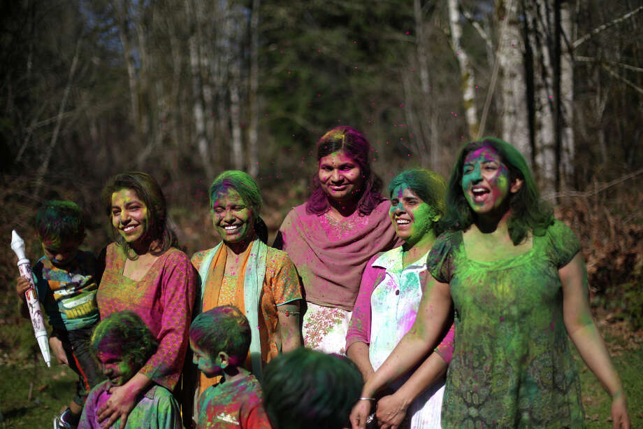 Participants show their color during a celebration of Holi, the Hindu festival of colors on Saturday, March 30, 2013 at the Sanatan Dharma Temple & Cultural Center in Maple Valley. The annual cultural and religious event is a time for Hindus to enjoy spring's abundant colors and say farewell to winter. Photo: JOSHUA TRUJILLO / SEATTLEPI.COM