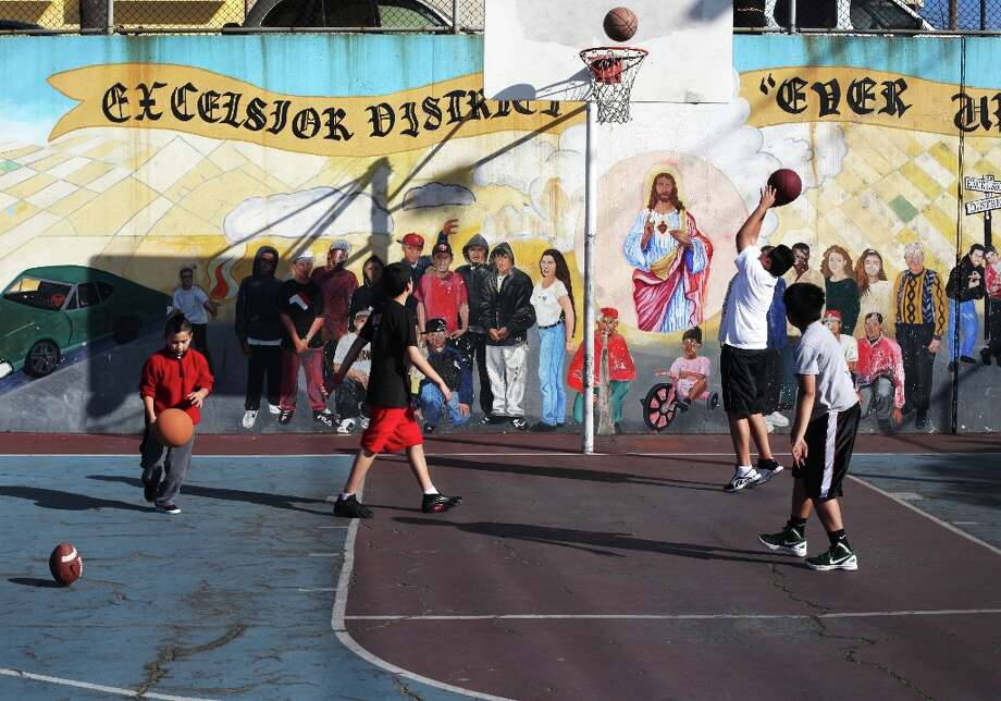 Dylan Palomino, 8, (l-r), Jonathan Rodriguez, 12, Brandon Palomino, 14, and Jesse Mateo, 11 play on the basketball court at Excelsior Playground on the Excelsior Heights hill on March 24, 2013 in San Francisco, Calif. The Palomino's are brothers, and all of the boys live in the neighborhood. Photo: Pete Kiehart, The Chronicle / ONLINE_YES