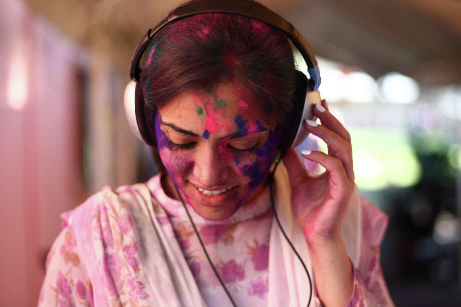 Deejay Pooja Walia plays music during a celebration of Holi, the Hindu festival of colors on Saturday, March 30, 2013 at the Sanatan Dharma Temple & Cultural Center in Maple Valley. The annual cultural and religious event is a time for Hindus to enjoy spring's abundant colors and say farewell to winter. Photo: JOSHUA TRUJILLO / SEATTLEPI.COM