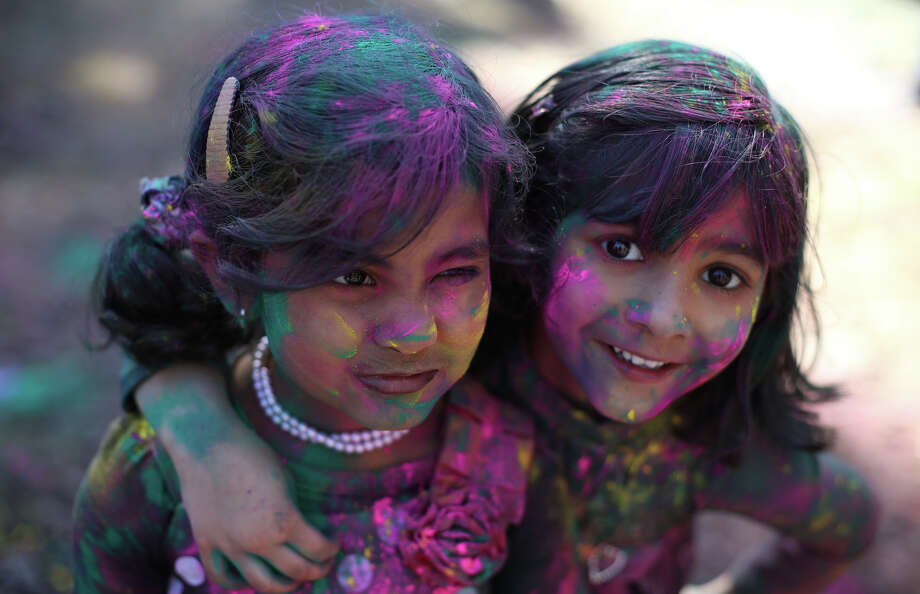 Young girls are covered with gulaal during a celebration of Holi, the Hindu festival of colors on Saturday, March 30, 2013 at the Sanatan Dharma Temple & Cultural Center in Maple Valley. The annual cultural and religious event is a time for Hindus to enjoy spring's abundant colors and say farewell to winter. Photo: JOSHUA TRUJILLO / SEATTLEPI.COM