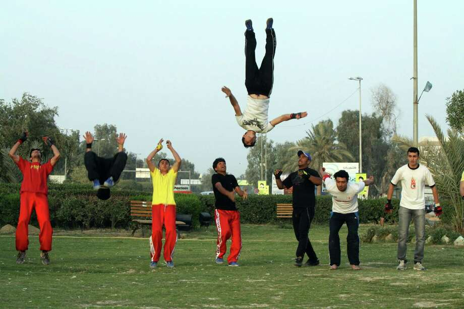 Young Iraqi men play Parkour, a French-born extreme sport at a park in the Shiite holy city of Najaf, 100 miles (160 kilometers) south of Baghdad, Iraq, Thursday, March 29, 2012. (AP Photo/Alaa al-Marjani) Photo: Alaa Al-Marjani, Associated Press / AP