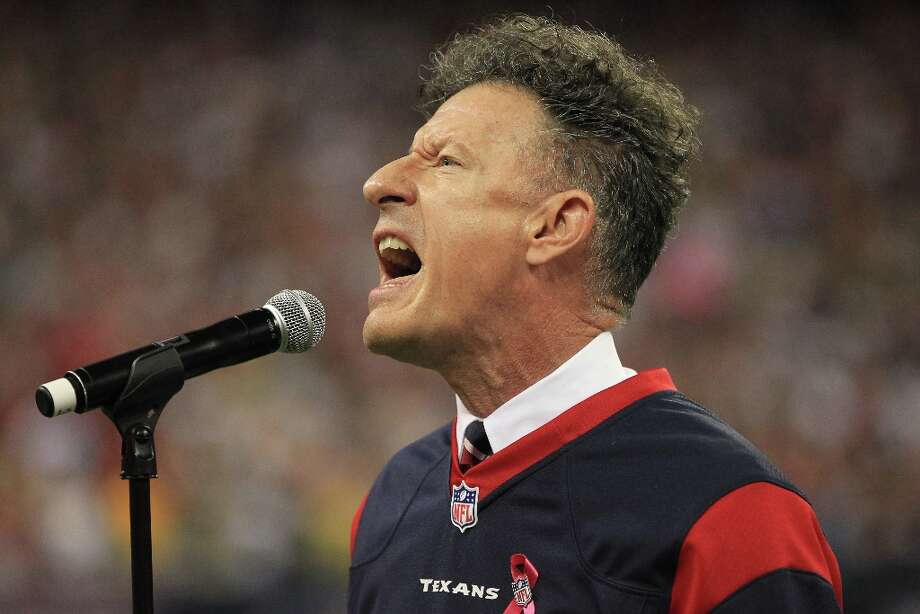 Lyle Lovett performs the national anthem before the Houston Texans game against the Green Bay Packers at Reliant Stadium on Sunday, Oct. 14, 2012, in Houston. Lovett will sing the national anthem at Astros opening day on March 31, 2013. Photo: Karen Warren, Houston Chronicle / © 2012  Houston Chronicle