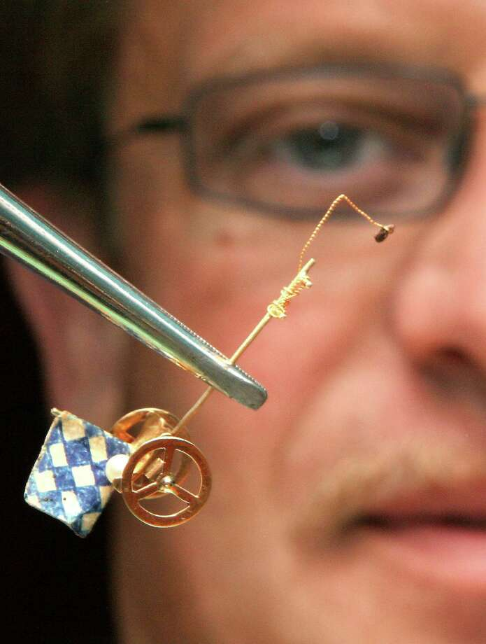 FILE - In this Sept. 14, 2005 file picture  Robert Birk  director of a German flea circus poses with a special cart with Bavarian flag  and one of his fleas at the Octoberfest beer festival in Munich. An entire troupe of performing fleas has fallen victim to freezing temperatures currently gripping Germany. Flea circus director Robert Birk says he was shocked to find all of his 300 fleas dead inside their transport box Wednesday morning. The circus immediately scrambled to find a new batch so it could fulfill its engagements at an open-air fair in the town of Mechernich-Kommern in western Germany. Michael Faber, who organizes the fair, told The Associated Press that an insect expert at a nearby university was able to train 50 fleas to in time for the first show Sunday March 31, 2013.  (AP Photo/dpa, Oliver Bodmer,File) Photo: DB Oliver Bodmer