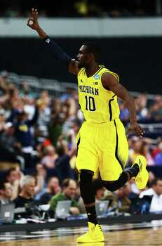 ARLINGTON, TX - MARCH 31:  Tim Hardaway Jr. #10 of the Michigan Wolverines celebrates a three pointer in the first half against the Florida Gators during the South Regional Round Final of the 2013 NCAA Men's Basketball Tournament at Dallas Cowboys Stadium on March 31, 2013 in Arlington, Texas. Photo: Tom Pennington, Getty Images / 2013 Getty Images