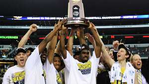 ARLINGTON, TX - MARCH 31:  Tim Hardaway Jr. #10 of the Michigan Wolverines and teammate celebrate their 79 to 59 win ovewr the Florida Gators during the South Regional Round Final of the 2013 NCAA Men's Basketball Tournament at Dallas Cowboys Stadium on March 31, 2013 in Arlington, Texas.