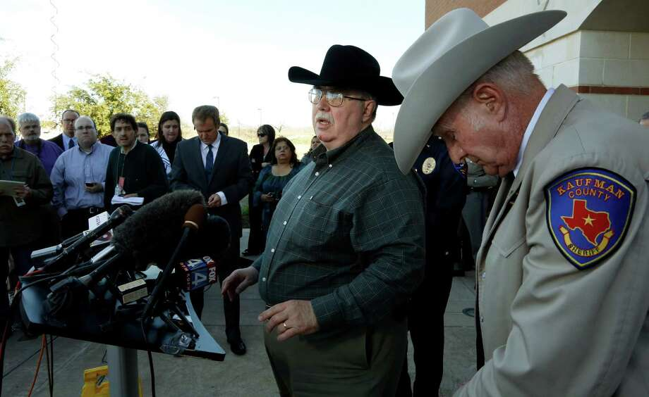 File- This Jan. 31, 2013 file photo shows David Byrnes, Sheriff of Kaufman County, right, bowing his head as Mike McLelland, District Attorney of Kaufman County answers questions at a news conference at the Kaufman Law Enforcement Center in Kaufman, Texas. McLelland and his wife where found dead in their home Saturday March 30, 2013. Authorities are investigating. Photo: The Dallas Morning News, David Woo
