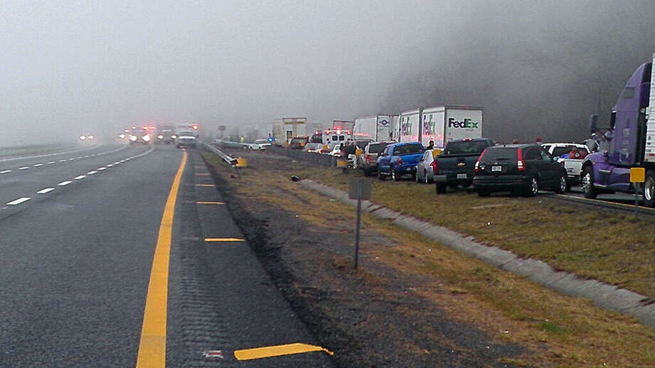 This image provided by WXII Channel 12 news,  shows the scene following a 75-vehicle pileup on Interstate 77 near the Virginia-North Carolina border in Galax, Va., on Sunday, March 31, 2013. Virginia State Police say three people have been killed and more than 20 are injured and traffic is backed up about 8 miles.  MANDAORY CREDIT: WXII,WILLIAM BOTTOMLEY Photo: WXII, William Bottomley