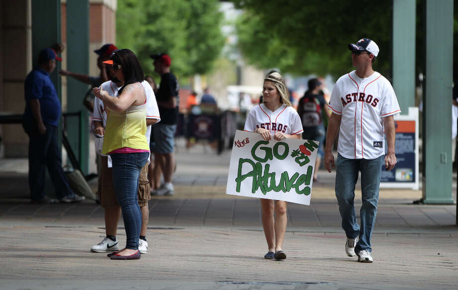 Serenity Brister, 15, of Livingston, walks with her dad, Cody Ragland outside of Minute Maid Park. Photo: Karen Warren, Houston Chronicle / © 2013 Houston Chronicle