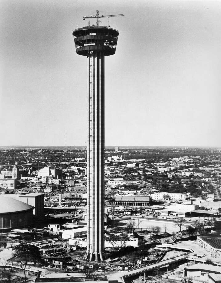 This file photo shows the Tower of the Americas as it appeared shortly after the tophouse was hoisted into place at the top of its concrete shaft in early 1968. By most accounts, construction of the tower posed the biggest challenge for developers of HemisFair '68. Photo: San Antonio Express-News File Photo / SAN ANTONIO EXPRESS-NEWS