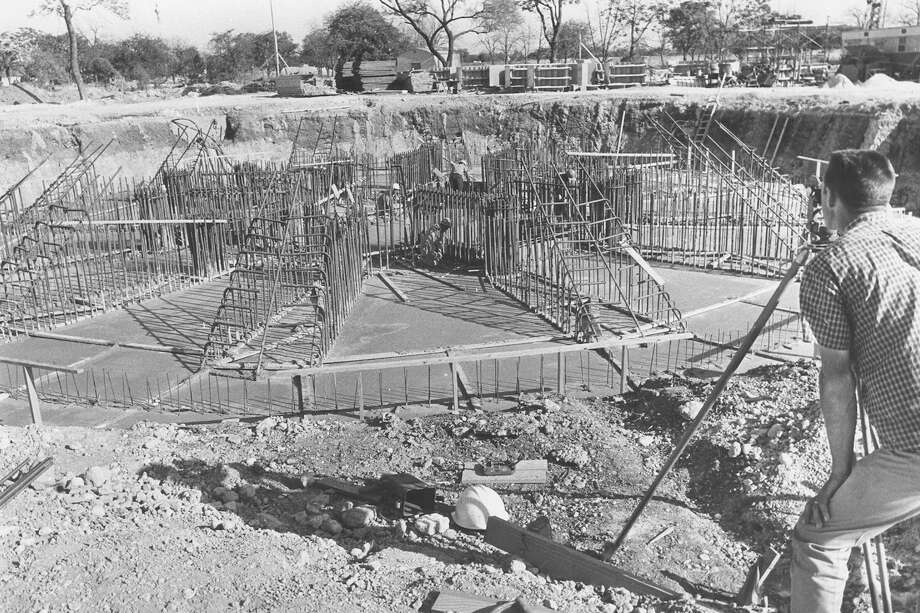 "From the caption published in the Express, April 4, 1967: ""With some 4,000 cubic yards of concrete in place, workmen Monday [April 3] completed the pouring of the 'cap' for the Tower of the Americas. The concrete will tie the foundation piers together, each of which goes down 60 feet. The start of the form construction on the tower itself is scheduled to start April 15 [1967]."" Photo: San Antonio Express-News File Photo"