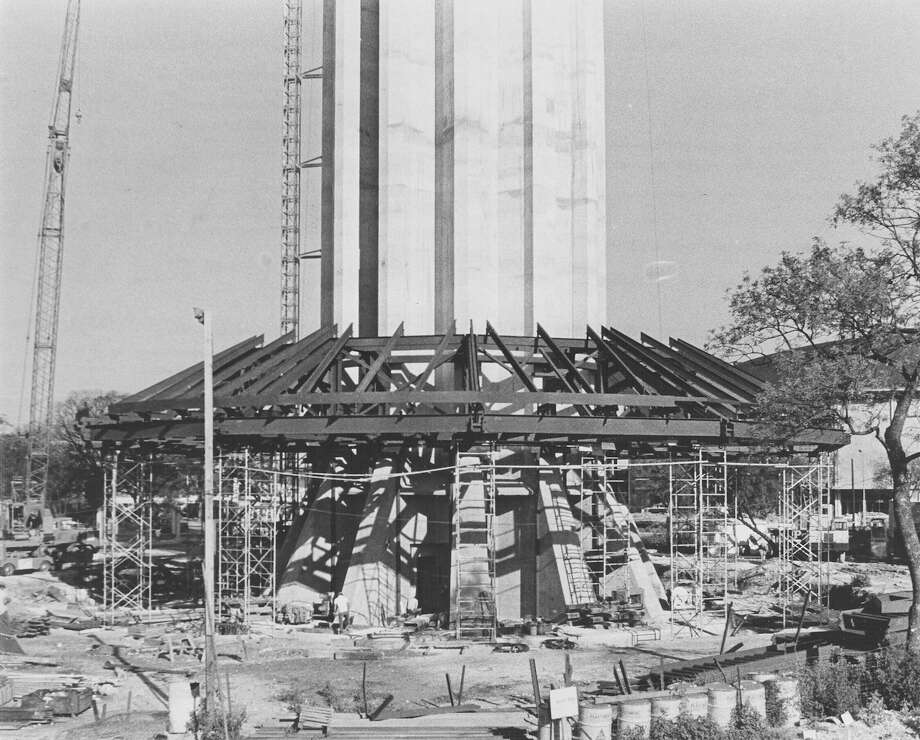 "Caption published in the News, Sept. 14, 1967: ""The top of the Tower of the Americas top house [sic] has taken shape around the base of the tower and workmen will soon start adding the floors beneath. When the framework is completed it will be lifted to the top of the tower. The tower grew eight feet last weekend [Sept. 9-10] for the tallest climb in three weeks. There will be no more concrete pouring for at least five weeks. The tower now stands 602 feet tall."" When completed, the tower is 622 feet tall.  Photo: San Antonio Express-News File Photo"