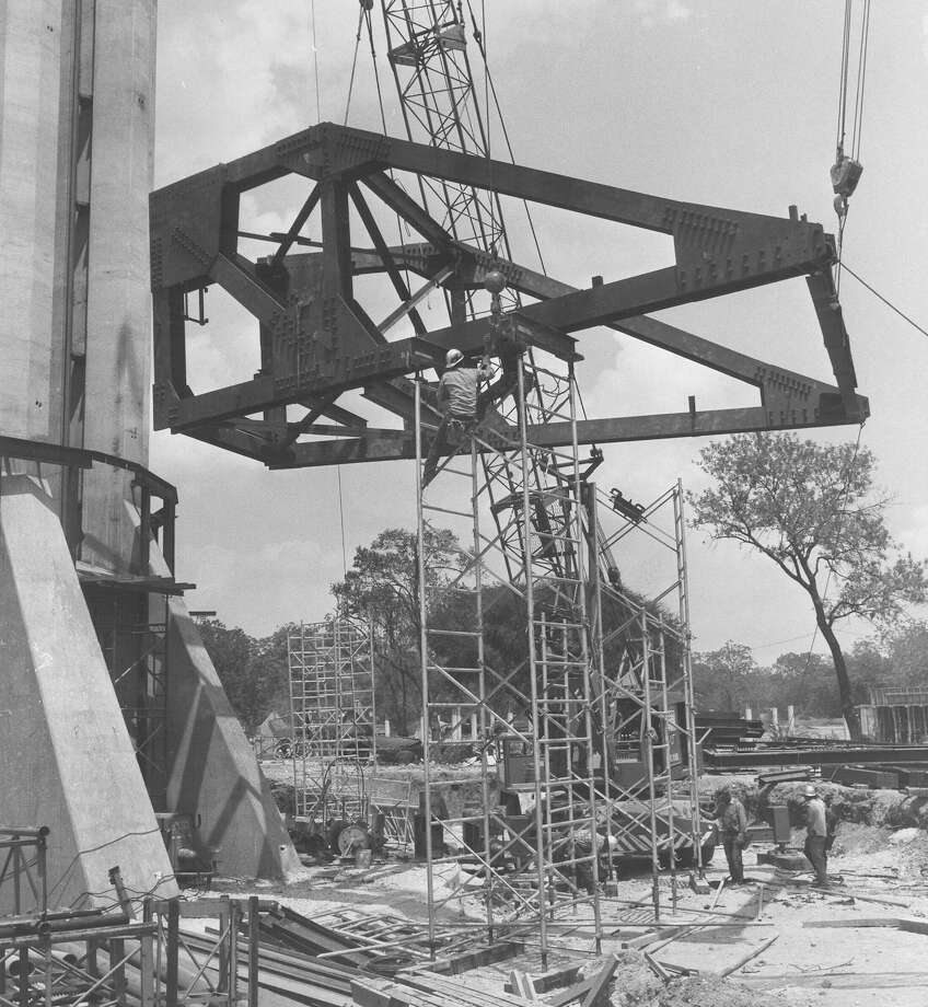 "From the caption published in the News, Aug. 17, 1967: ""One of [the] huge prefabricated sections of steel that will form part of the tophouse for the Tower of the Americas is shown being lifted into place. The frame for the tophouse will be built around the base of the tower and then lifted into place.""  Photo: San Antonio Express-News File Photo"