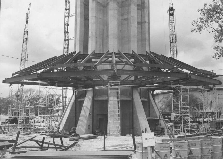 "From the caption published in the Express, Aug. 25, 1967: ""The framework for the roof of the Tower of the Americas Tophouse looks like an umbrella as it stands at the base of the 622-foot structure. The entire tophouse will be built around the base of the tower and then will be hoisted up the stem by hydraulic jacks."" Photo: San Antonio Express-News File Photo"