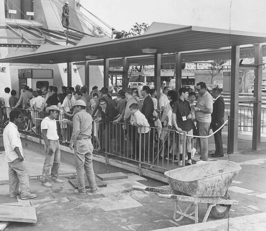 Construction continues at the base as a crowd waits for a trip to the tophouse at the Tower of the Americas on April 11, 1968, the Tower's first day open to the public, during HemisFair '68. Photo: San Antonio Express-News File Photo