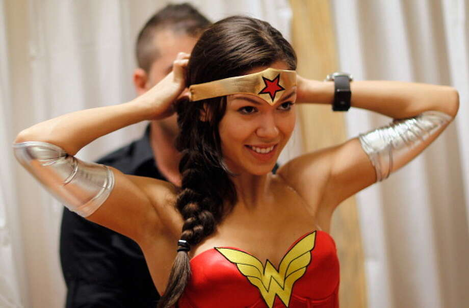 Madeleine Wenthzel tries on a Wonder Woman Costume at the Halloween MegaStore Miami Beach  on October 21, 2011 in Miami Beach, Florida. Photo: Joe Raedle, Getty Images / 2011 Getty Images