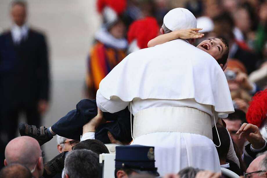 VATICAN CITY, VATICAN - MARCH 31:  Pope Francis holds a disabled child as he greets the faithful prior to his first 'Urbi et Orbi' blessing from the balcony of St. Peter's Basilica during Easter Mass on March 31, 2013 in Vatican City, Vatican. Pope Francis delivered his message to the gathered faithful from the central balcony of St. Peter's Basilica in St. Peter's Square after his first Holy week as Pontiff.  (Photo by Dan Kitwood/Getty Images) Photo: Dan Kitwood, Getty Images