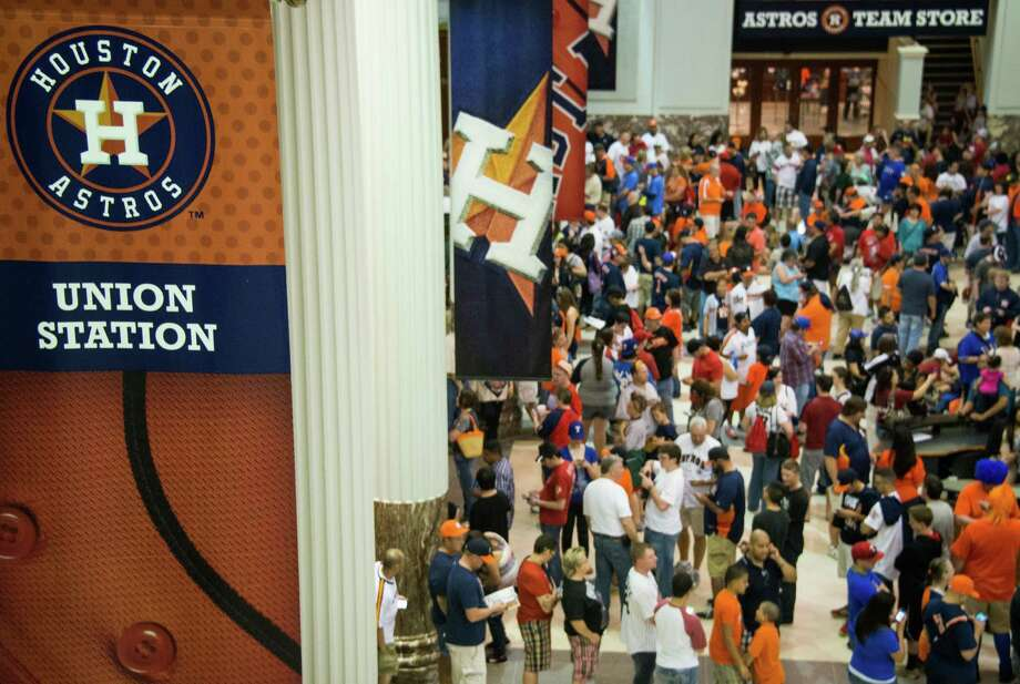 PHOTOS: Strangest things to happen at Minute Maid Park during an Astros game Fans pack the lobby of Union Station waiting for the gates to open before the Houston Astros season opener against the Texas Rangers at Minute Maid Park on Sunday, March 31, 2013, in Houston. Photo: Smiley N. Pool, Houston Chronicle / © 2013  Smiley N. Pool