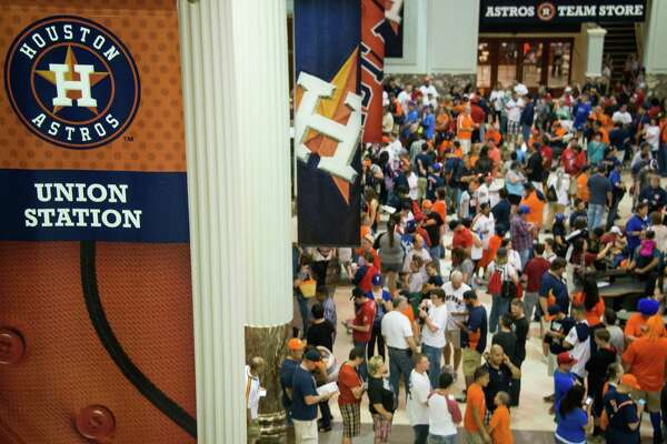 Fans pack the lobby of Union Station waiting for the gates to open before the Houston Astros season opener against the Texas Rangers at Minute Maid Park on Sunday, March 31, 2013, in Houston.