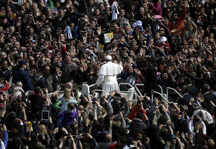 Pope Francis waves to faithful at the end of the Easter mass in St. Peter's Square at the Vatican, Sunday, March 31, 2013. Pope Francis made an Easter Sunday peace plea, saying conflicts have lasted too long in Syria, and between Israelis and Palestinians. (AP Photo/Gregorio Borgia) Photo: Gregorio Borgia, Associated Press