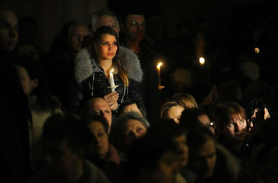 Russian Catholics hold candles during an Easter vigil on Holy Saturday at the Cathedral of Virgin Mary Immaculate Conception in Moscow on March 30, 2013.  Easter Vigil, also called the Paschal Vigil, is a service held in traditional Christian churches as the first official celebration of the resurrection of Jesus. While most Russians will mark Orthodox Easter on May 5, according to the old Julian calendar, Easter in the West is celebrated on March 30 by Russia's 600,000-strong Roman Catholic community.       AFP PHOTO / ANDREY SMIRNOVANDREY SMIRNOV/AFP/Getty Images Photo: Andrey Smirnov, AFP/Getty Images