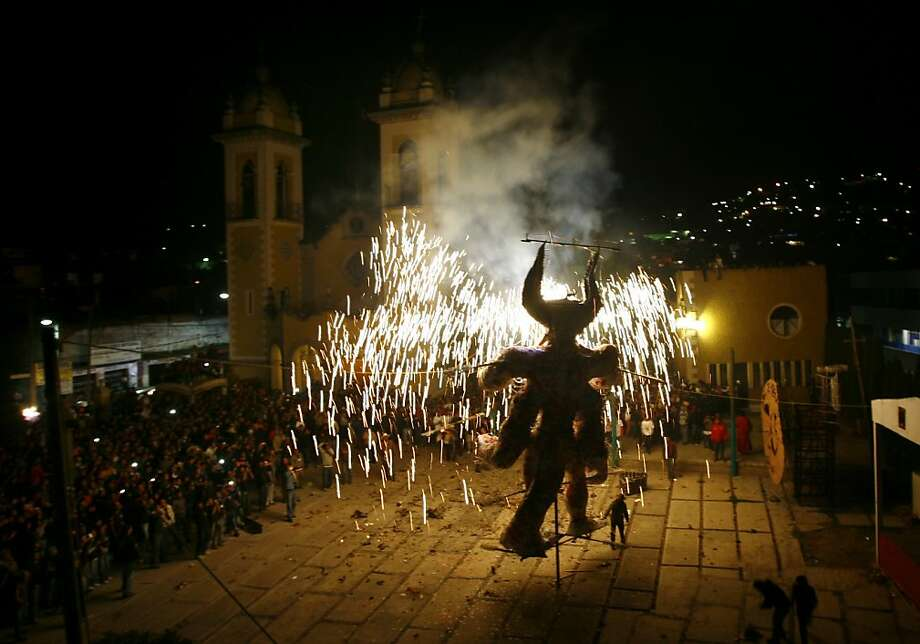 A giant 5-meter tall figure representing Judas burns in the atrium of the Santa Rosa Xochiac church, in Mexico City,  Sunday, March 31, 2013. The Burning of Judas is an Easter ritual in many communities, where an effigy of Judas Iscariot is hung on Good Friday, then burned on Easter Sunday. (AP Photo/Marco Ugarte) Photo: Marco Ugarte, Associated Press
