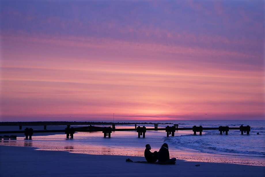 Brandon McHale and Becky McNulty, of Ambler. Pa., sit on the beach and wait for sunrise on Easter morning in Ocean City, N.J., Sunday, March 31, 2013. (AP Photo/Mel Evans) Photo: Mel Evans, Associated Press