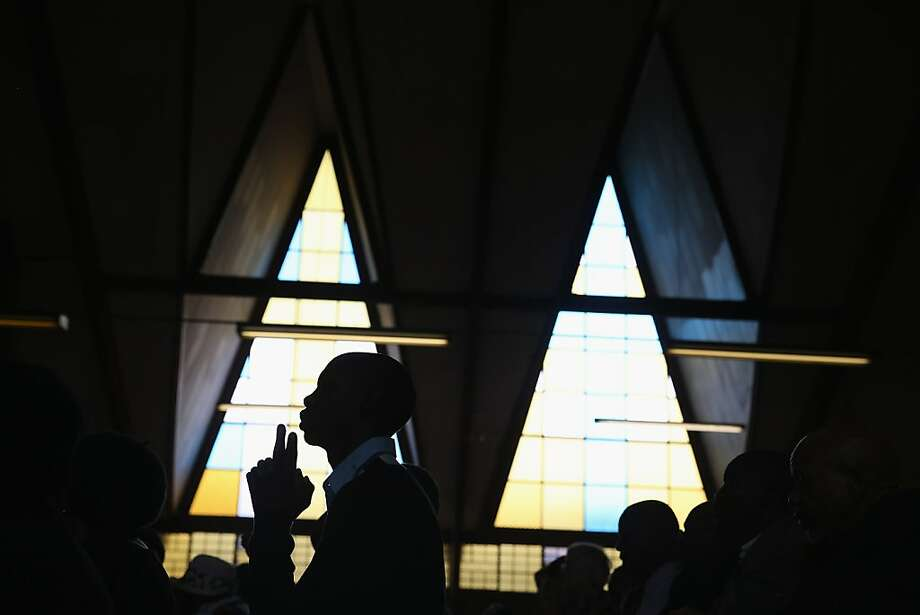 "JOHANNESBURG, SOUTH AFRICA - MARCH 31:  Congregants pray during Easter services at Regina Mundi Catholic Church in the Soweto area March 31, 2013 in Johannesburg, South Africa. A central gathering place during he anti-apartheid struggle, the church held prayers for former South African President Nelson Mandela, 94, who is in the hospital for the third time since December with lung problems. Referring to Mandela by clan name, Madiba, President Jacob Zuma said, ""We appeal to the people of South Africa and the world to pray for our beloved Madiba and his family and to keep them in their thoughts."" Mandela's lungs were damaged when he contracted tuberculosis during his 27 years in the infamous Robben Island prison. Mandela became the nation's first democratically elected president in 1994 following the end of apartheid.  (Photo by Chip Somodevilla/Getty Images) Photo: Chip Somodevilla, Getty Images"