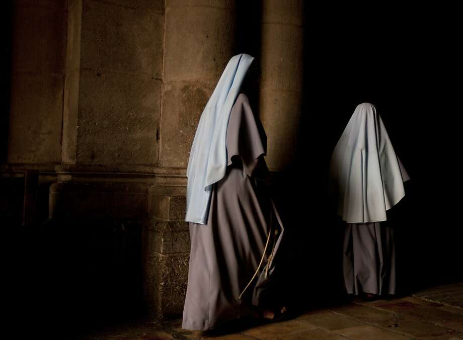 Nuns walk during the Sunday Easter mass at the Church of the Holy Sepulcher, traditionally believed to be the site of the crucifixion of Christ, in Jerusalem's Old City, Sunday, March 31, 2013. (AP Photo/Sebastian Scheiner) Photo: Sebastian Scheiner, Associated Press