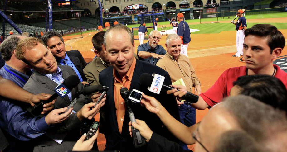 Astros owner Jim Crane talks to the media during batting practice. Photo: Karen Warren, Houston Chronicle / © 2013 Houston Chronicle