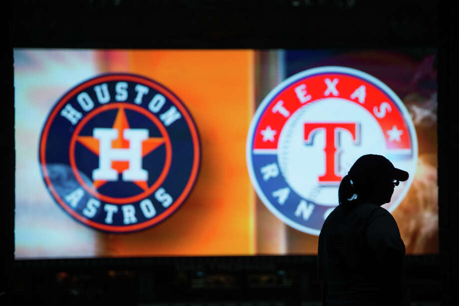 The logos of the Astros and the Rangers fill the video screen as fans arrive. Photo: Smiley N. Pool, Houston Chronicle / © 2013  Smiley N. Pool