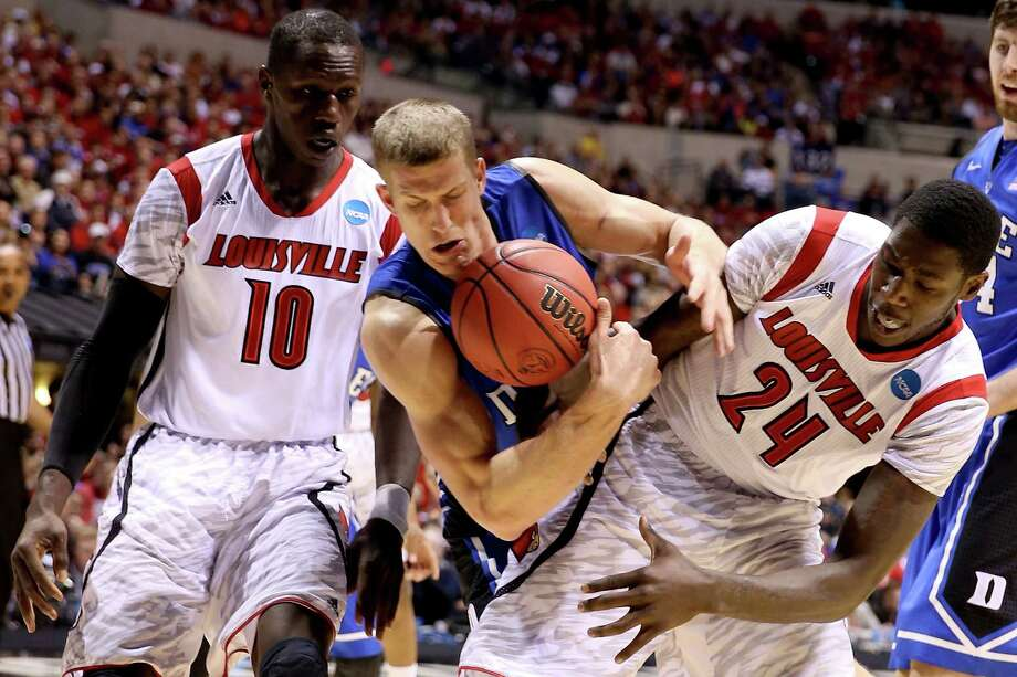 INDIANAPOLIS, IN - MARCH 31:  Mason Plumlee #5 of the Duke Blue Devils attempts to ocntrol the against the Louisville Cardinals in the second half against Gorgui Dieng #10 and Montrezl Harrell #24 of the Louisville Cardinals during the Midwest Regional Final round of the 2013 NCAA Men's Basketball Tournament at Lucas Oil Stadium on March 31, 2013 in Indianapolis, Indiana. Photo: Andy Lyons, Getty Images / 2013 Getty Images