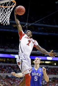 Louisville guard Russ Smith (2) goes up with a layup past Duke's Mason Plumlee (5) during the first half of the Midwest Regional final in the NCAA college basketball tournament, Sunday, March 31, 2013, in Indianapolis. (AP Photo/Michael Conroy) Photo: Michael Conroy, Associated Press / AP