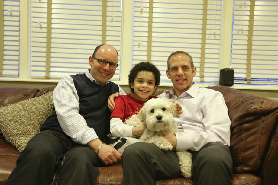 Jeff Friedman (left) and Andrew Zwerin, with their 9-year-old son, Joshua, at their home in New York, are waiting for the U.S. Supreme Court decision regarding the Defense of Marriage Act.  The eradication of DOMA by the court  would help the couple financially but it might not ease the practical challenges they face. Photo: Michelle V. Agins / New York Times