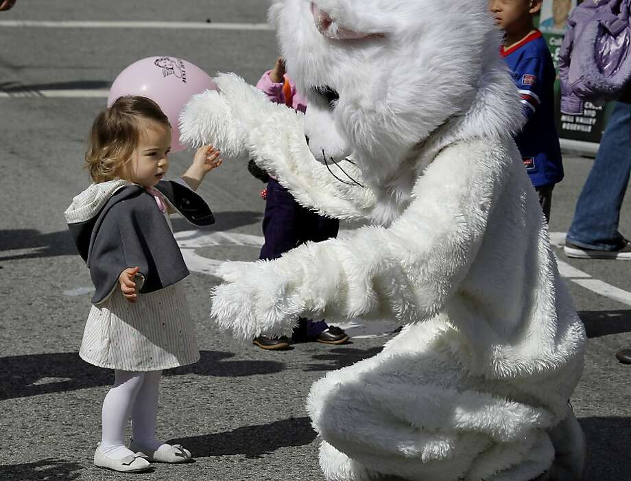 Fionna Castellanos, 2 years old, was not afraid of a big white cat on Union Street. The 22nd annual Easter Parade and Spring Celebration on Union Street in San Francisco, Calif. attracted thousands of people on a slightly rainy day Sunday March 31, 2013. Photo: Brant Ward, The Chronicle