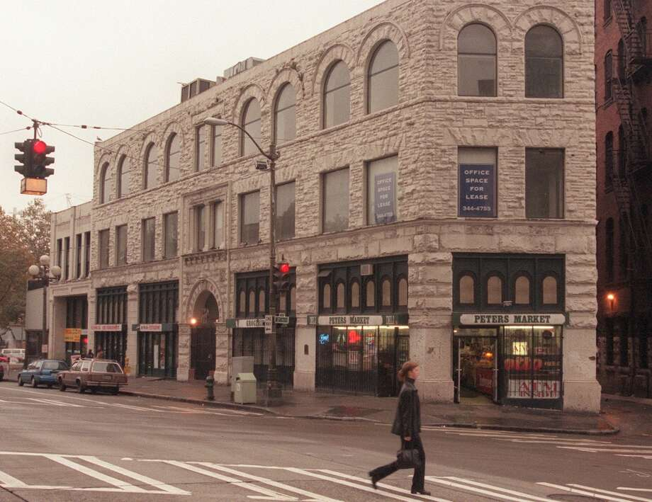 Here's the Metropole when it was still occupied in the '90s. A sandstone trapezoid at Second and Yesler, it supposedly was the site for pioneer Henry Yesler's first office. The building was home for decades to G.O. Guy's Drugstore, and it's also where a disgraced Seattle police chief was shot to death in 1901.