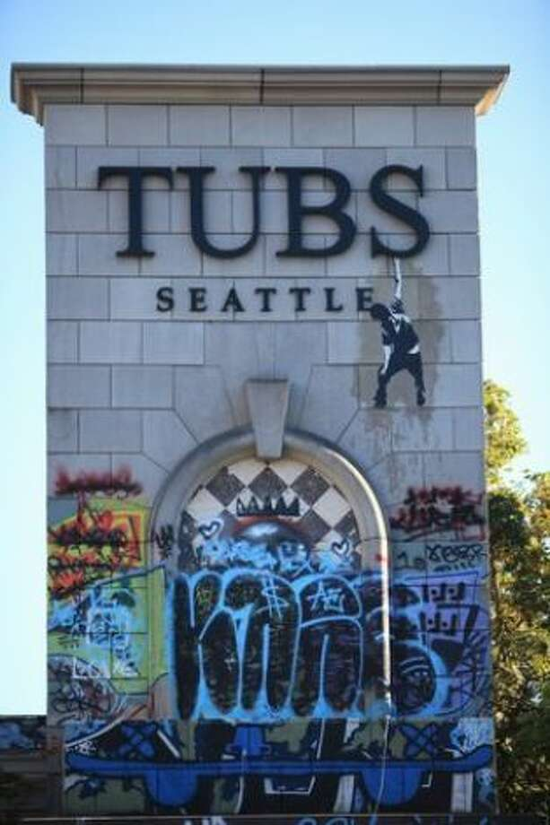 The property owner of the Tubs building once had plans to demolish it for a new building. But he lost financing and decided to leave the empty building up for taggers. It's since become a notorious graffiti landmark. Read more here. Photo: Joshua Trujillo / seattlepi.com
