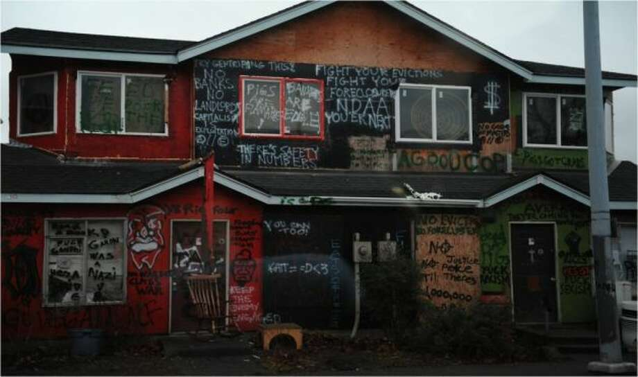 ''Occupy Seattle'' house: This vacant Central District house across from Garfield High School became the home of ''Occupy'' squatters and taggers in 2012. Then King County Sheriff's deputies and a SWAT team kicked them out. Photo: King County Sherriff's Office Photo