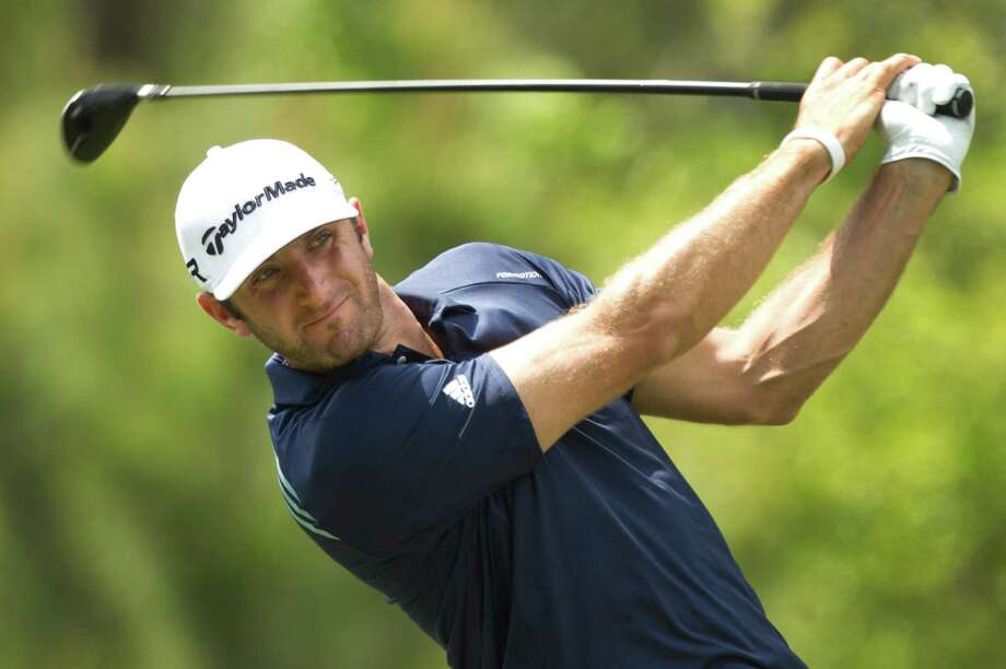 Dustin Johnson tees off on No. 12 during the final round of the Shell Houston Open at the Redstone Tournament Course Sunday, March 31, 2013, in Humble. Photo: Brett Coomer, Houston Chronicle / © 2013 Houston Chronicle
