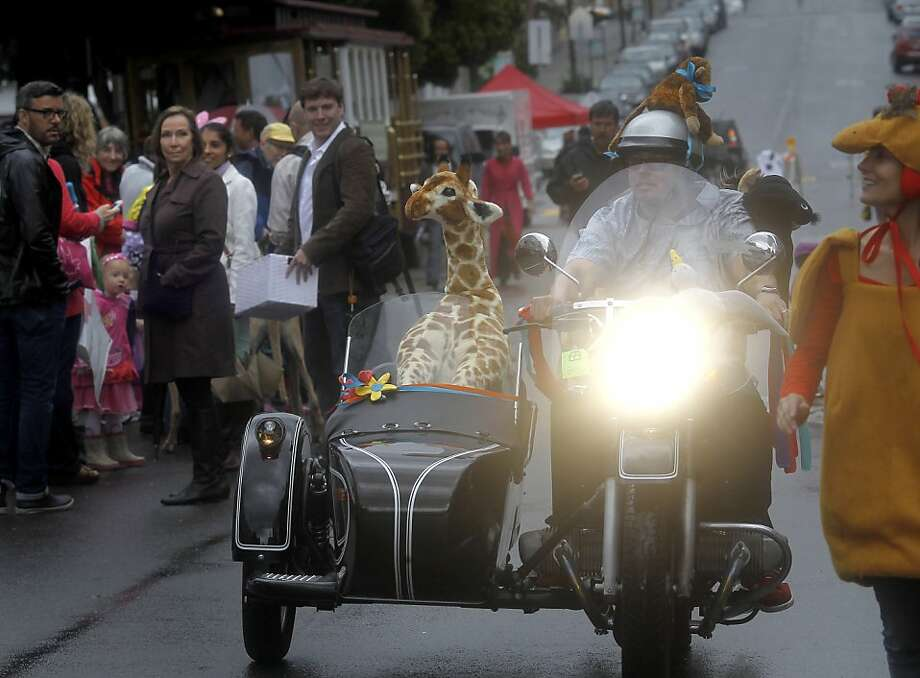Mark Hartman had his motorcycle all decked out for the parade. The 22nd annual Easter Parade and Spring Celebration on Union Street in San Francisco, Calif. attracted thousands of people on a slightly rainy day Sunday March 31, 2013. Photo: Brant Ward, The Chronicle