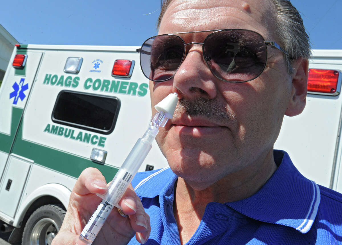 Hoags Corners EMT Paul Glasser demonstrates how the drug Naloxone Hydrochloride is administered at the Hoags Corners ambulance garage Friday, May 18, 2012 in East Nassau, N.Y. The Hoags Corners EMTs are the first in a pilot program that allows EMTs to administer a drug that can reverse an opioid overdose. (Lori Van Buren / Times Union)