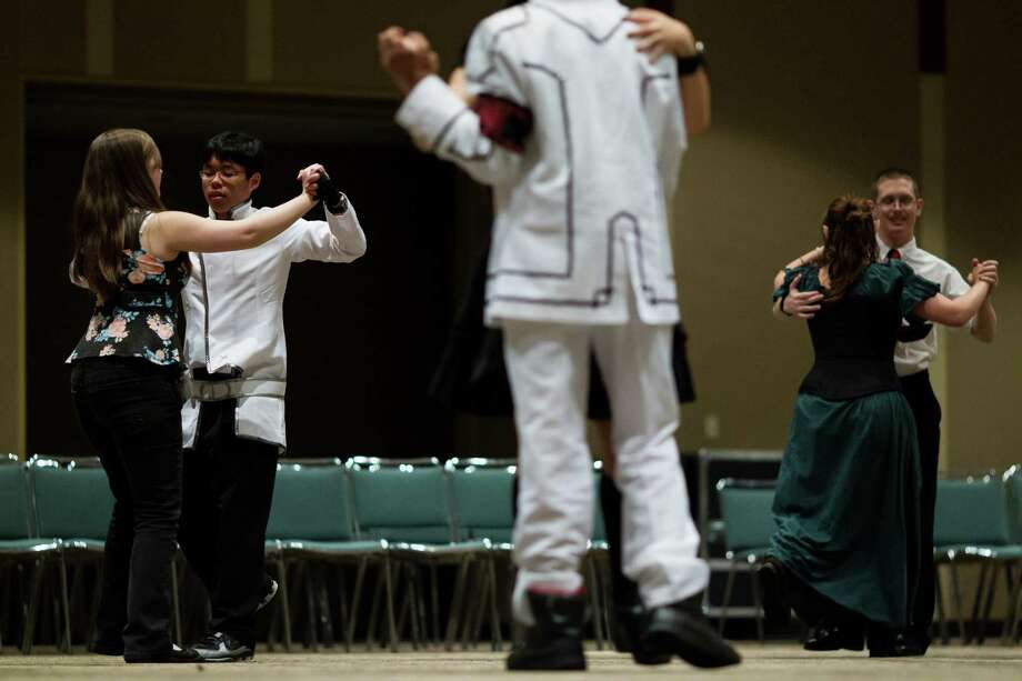 Couples pair off to practice their dance moves during the 16th annual Sakura-Con Sunday, March 31, 2013, at the Washington State Convention Center in Seattle. Presented by the Asia Northwest Cultural Education Association, Sakura-Con featured three days of anime theaters, gaming, cosplay, cultural panels, dances, concerts, art contests and industry guests. Photo: JORDAN STEAD / SEATTLEPI.COM