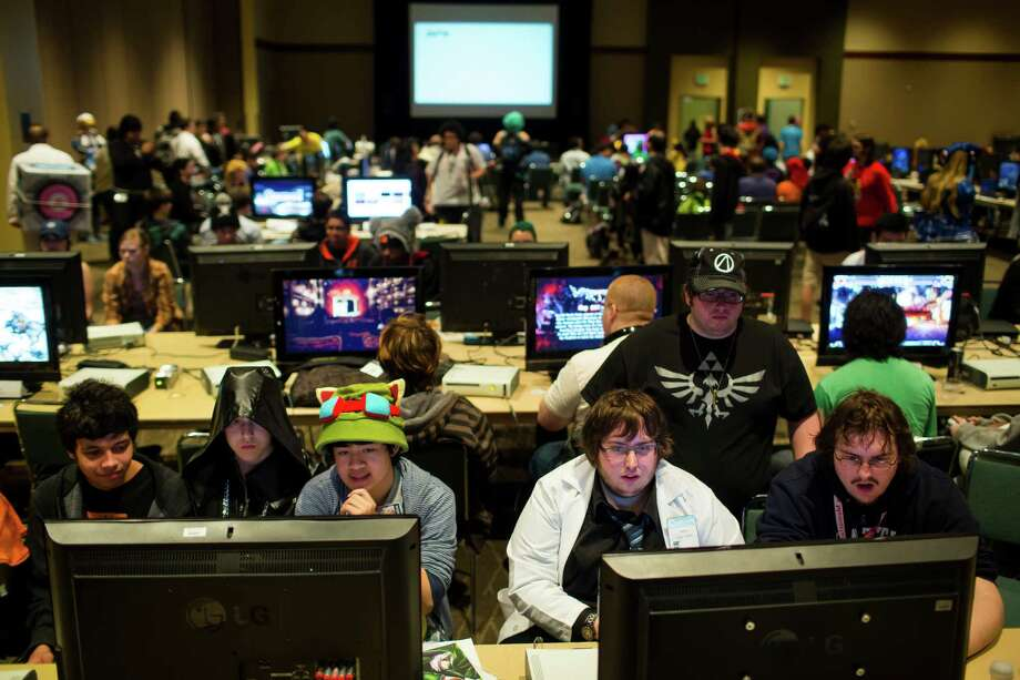 Some attendees skipped out on sun and ventured indoors to enjoy a host of video games on both vintage and contemporary systems during the 16th annual Sakura-Con Sunday, March 31, 2013, at the Washington State Convention Center in Seattle. Presented by the Asia Northwest Cultural Education Association, Sakura-Con featured three days of anime theaters, gaming, cosplay, cultural panels, dances, concerts, art contests and industry guests. Photo: JORDAN STEAD / SEATTLEPI.COM