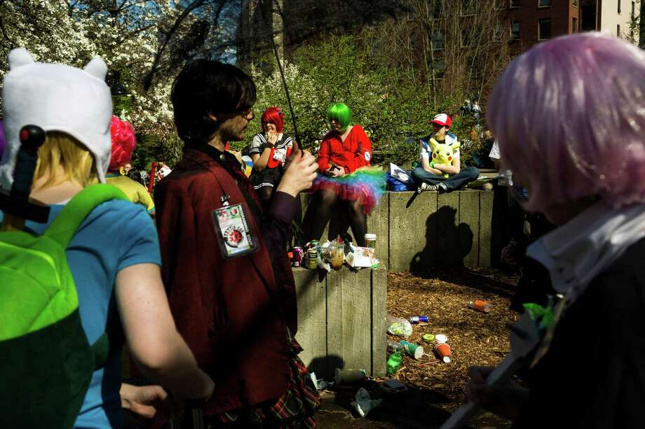 Groups of colorfully dressed attendees enjoy lunch outside during the 16th annual Sakura-Con Sunday, March 31, 2013, at the Washington State Convention Center in Seattle. Presented by the Asia Northwest Cultural Education Association, Sakura-Con featured three days of anime theaters, gaming, cosplay, cultural panels, dances, concerts, art contests and industry guests. Photo: JORDAN STEAD / SEATTLEPI.COM