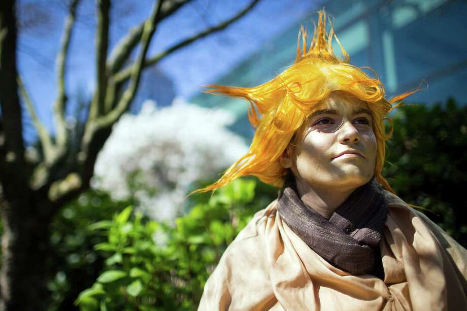 "Suraya Carrim, dressed as ""The Sandman,"" people watches outside during the 16th annual Sakura-Con Sunday, March 31, 2013, at the Washington State Convention Center in Seattle. Presented by the Asia Northwest Cultural Education Association, Sakura-Con featured three days of anime theaters, gaming, cosplay, cultural panels, dances, concerts, art contests and industry guests. Photo: JORDAN STEAD / SEATTLEPI.COM"