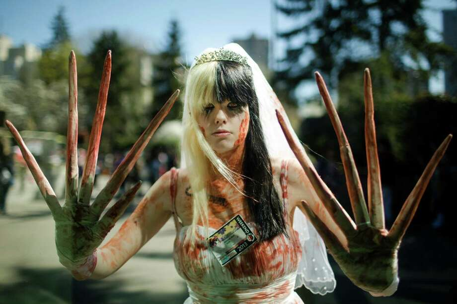 Dressed as an undead prom date, Katie Steed shows off her abnormally large claws during the 16th annual Sakura-Con Sunday, March 31, 2013, at the Washington State Convention Center in Seattle. Presented by the Asia Northwest Cultural Education Association, Sakura-Con featured three days of anime theaters, gaming, cosplay, cultural panels, dances, concerts, art contests and industry guests. Photo: JORDAN STEAD / SEATTLEPI.COM